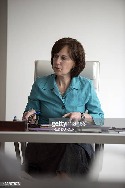 French junior minister for Family Elderly and Autonomy Laurence Rossignol poses in her office at the minister on June 02 2014 Paris AFP PHOTO / FRED...