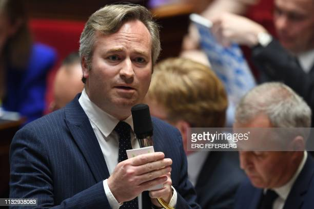 French Junior Minister for Foreign Affairs JeanBaptiste Lemoyne gestures as he speaks during a session of questions to the government at the National...