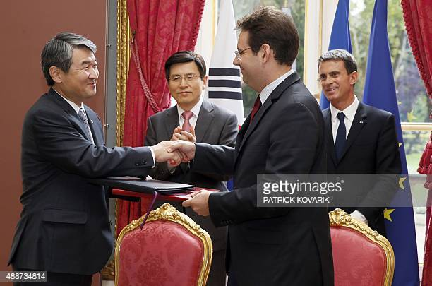 French Junior Minister for Foreign Trade and Tourism Matthias Fekl shakes hands with South Korean ViceForeign Affairs Minister Cho Taeyong following...