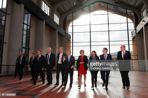 French junior minister for Sports Thierry Braillard IOC member Guy Drut cochairman of the Paris 2024 Olympic Paralympic Games bid Bernard Lapasset...