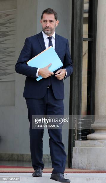 French Junior Minister for the Relations with Parliament and Government Spokesperson Christophe Castaner walks after leaving a Council of Ministers...