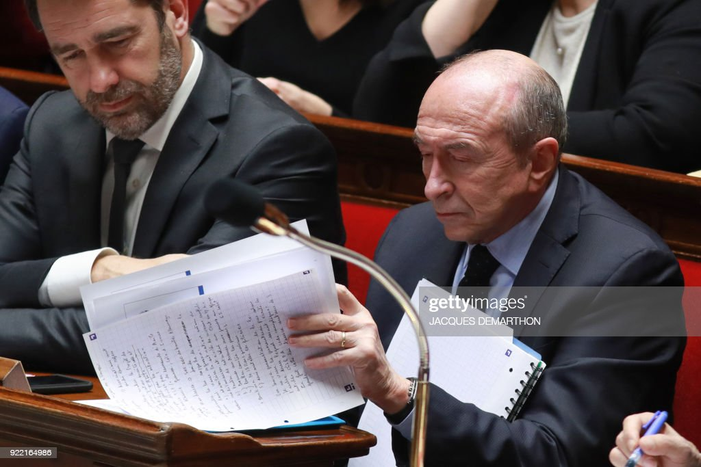 French Junior Minister for the Relations with Parliament Christophe Castaner (L) and French Interior Minister Gerard Collomb attend a session of questions to the government at the National Assembly in Paris on February 21, 2018. /