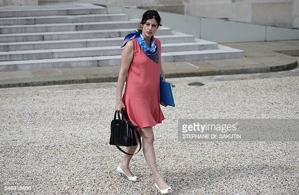French junior minister for victims aid Juliette Meadel holds documents at the Elysee presidential Palace after a weekly cabinet meeting on July 13...