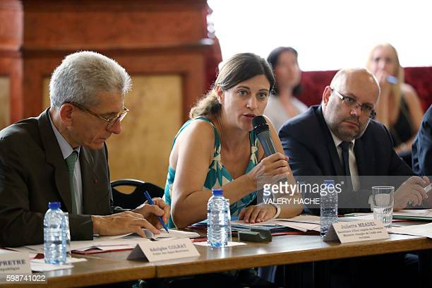 French Junior Minister for Victims Aid Juliette Meadel next to the Prefect of the Alpes Maritimes region Adolphe Colrat and Nice Mayor Philippe...