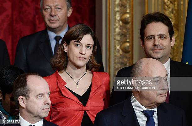 French junior minister for victims aid Juliette Meadel poses with other members of the government for a family picture at the Elysee presidential...