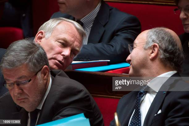 French Junior Minister in Charge of Relations with the Parliament Alain Vidalies French Prime Minister JeanMarc Ayrault and French Minister of...