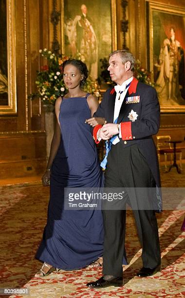 French Junior Minister Rama Yade walks with Prince Andrew Duke of York at Windsor Castle to a State Banquet on the first day of President Sarkozy's...