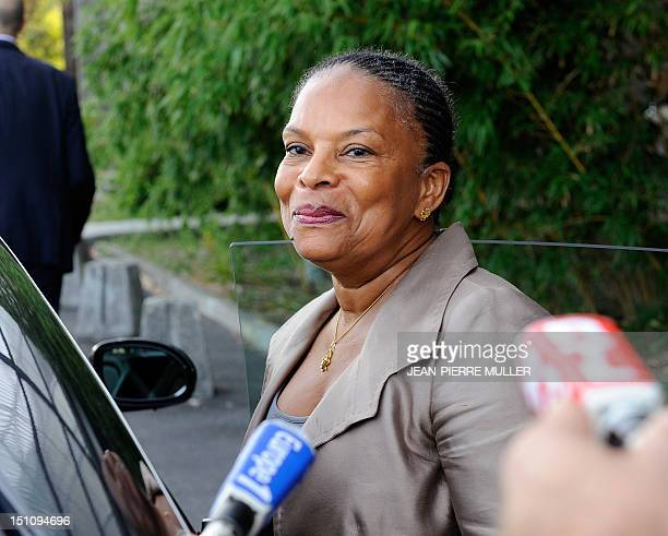 French Justice Minister Christiane Taubira answers journalists' questions as she leaves the Haut Leveque de Pessac hospital on September 1 in...