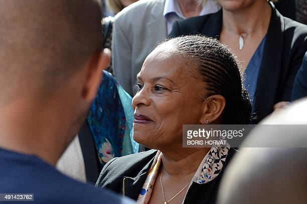 French Justice Minister Christiane Taubira smiles as she speaks to people during a visit to a UEMO an educational open custody facility for convicted...