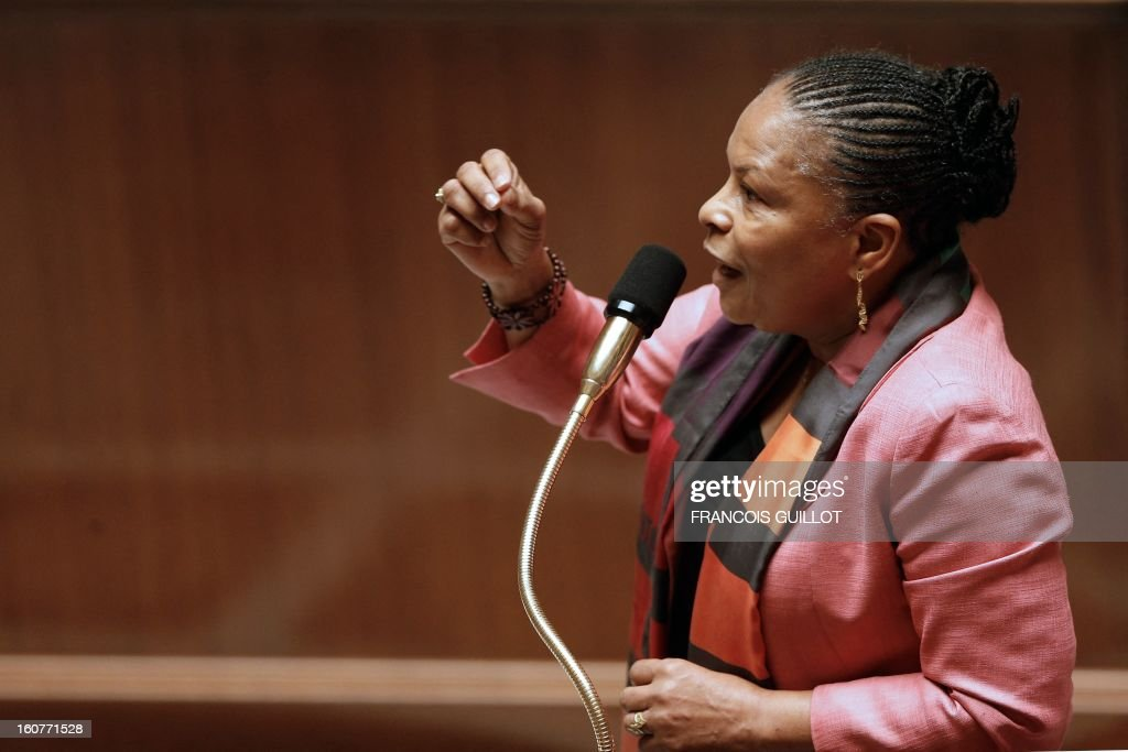 French Justice Minister Christiane Taubira takes part in the debate to allow gay couples to get married and adopt children on February 5, 2013 at the National Assembly in Paris. Three days before, members of Parliament voted 249-97 in favour of Article One of the draft law, which redefines marriage as being a contract between two people rather than necessarily between a man and a woman.