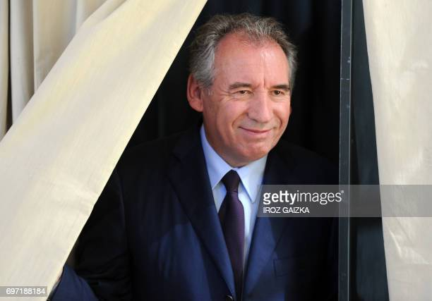 French Justice Minister Francois Bayrou leaves a voting booth at a polling station in Pau southwestern France on June 18 during the second round of...