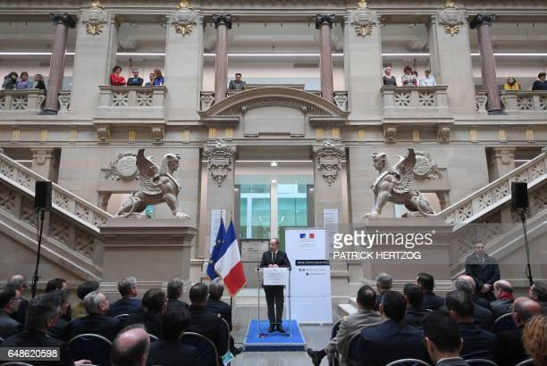French Justice Minister Jean-Jacques Urvoas gives a speech in the waiting hall of the courthouse during its inauguration after renovation work on...