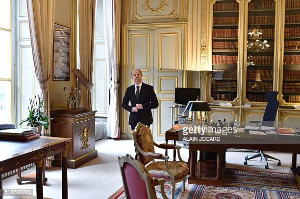 French Justice minister JeanJacques Urvoas poses in his office at the Justice Ministry in Paris on March 4 2016 / AFP / ALAIN JOCARD