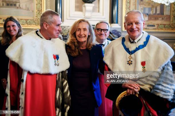 French Justice minister Nicole Belloubet poses for a photograph flanked by the newly appointed general prosecutor at the French Cassation court...