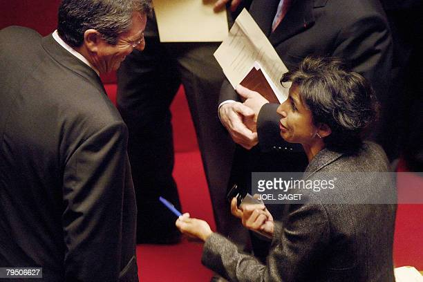 French Justice Minister Rachida Dati talks to LevalloisPerret's mayor Patrick Balkany on February 4 2008 at Versailles castle west of Paris where...
