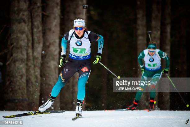 French Justine Braisaz and Italy's Dorothea Wierer compete during the Mixed Relay competition of the IBU Biathlon World Cup in Pokljuka on December 2...