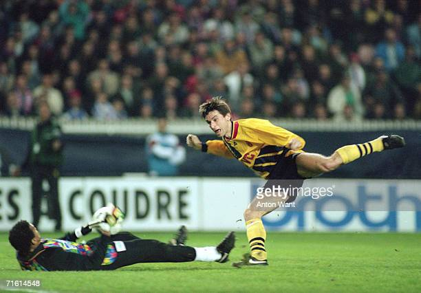 French keeper Bernard Lama makes a save from striker Alan Smith during the first leg of the European Cup Winners Cup semi final between Paris Saint...