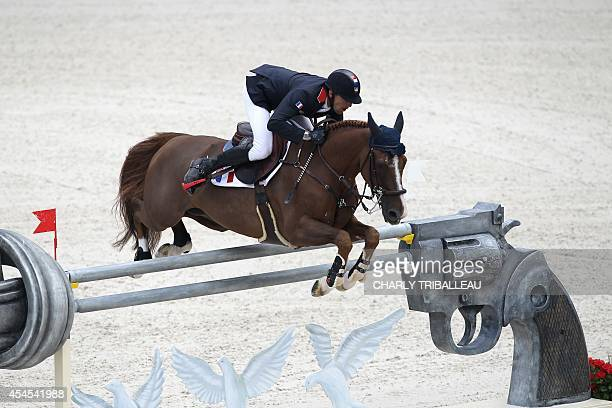 French Kevin Staut rides Reveur de Hurtebise HDC on September 3 2014 during the Individual Jumping competition of the 2014 FEI World Equestrian Games...