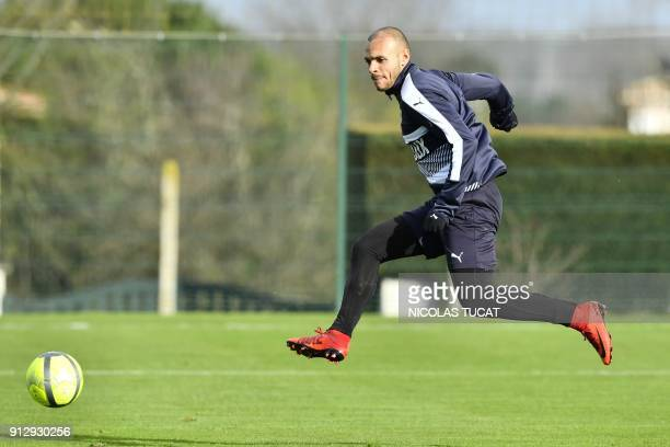 French L1 football club FC Girondins de Bordeaux' newly recruited Danish forward Martin Braithwaite shoots a ball during a training session on...