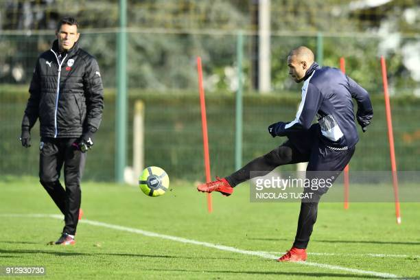 French L1 football club FC Girondins de Bordeaux' newly recruited Danish forward Martin Braithwaite shoots a ball as Uruguayan head coach Gustavo...