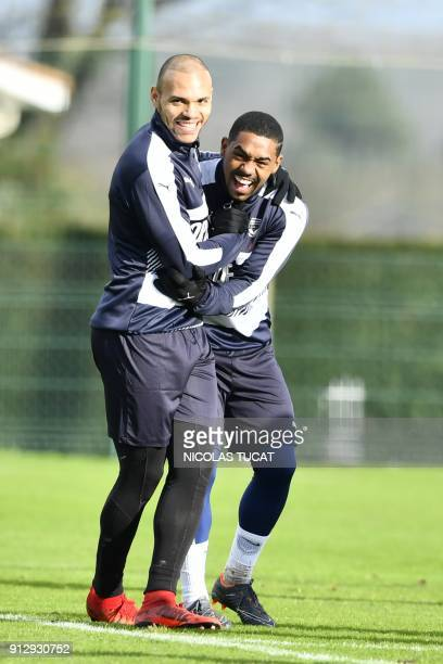 French L1 football club FC Girondins de Bordeaux' newly recruited Danish forward Martin Braithwaite smiles with Bordeaux's Brazilian forward Malcom...