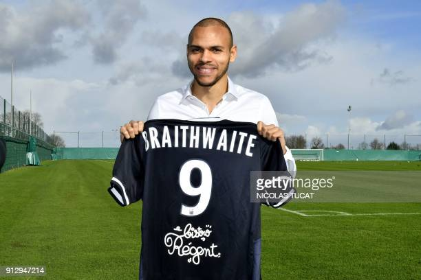 French L1 football club FC Girondins de Bordeaux' newly recruited Danish forward Martin Braithwaite poses with his jersey during his official...