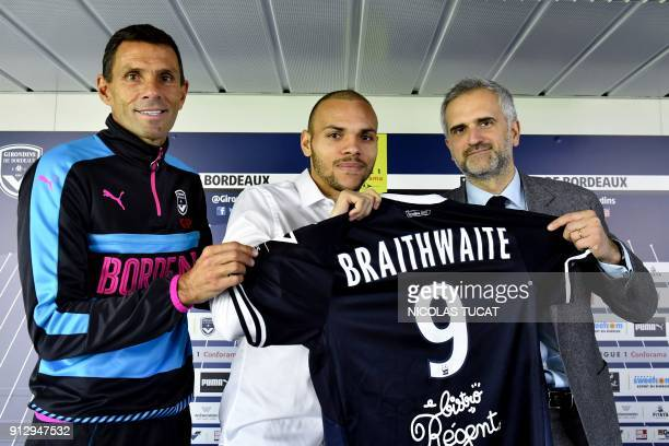 French L1 football club FC Girondins de Bordeaux' newly recruited Danish forward Martin Braithwaite poses with his jersey next to Bordeaux's...
