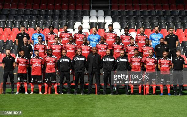 French L1 football club Guingamp's players and staff pose for the official photograph at the Roudourou stadium in Guingamp western France on...