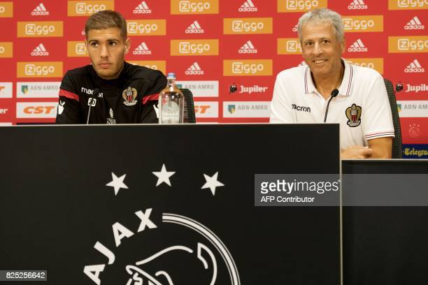 French L1 football Nice club's Swiss head coach Lucien Favre and player Maxime Marchand give a press conference at the Arena on August 1 2017 in...