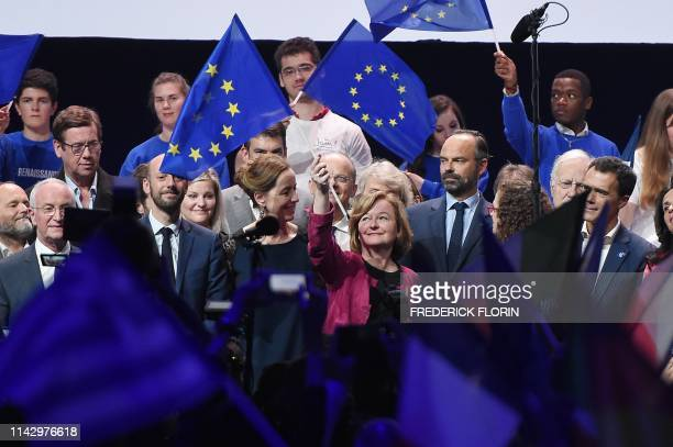 French La Republique En Marche 's front runner candidate for the upcoming European elections Nathalie Loiseau waves a European flag next to senator...