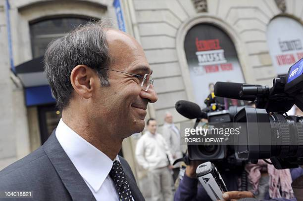 French Labour Minister Eric Woerth smiles to journalists as he leaves the Europe1 radio studio on September 12, 2010 in Paris, after taking part to...