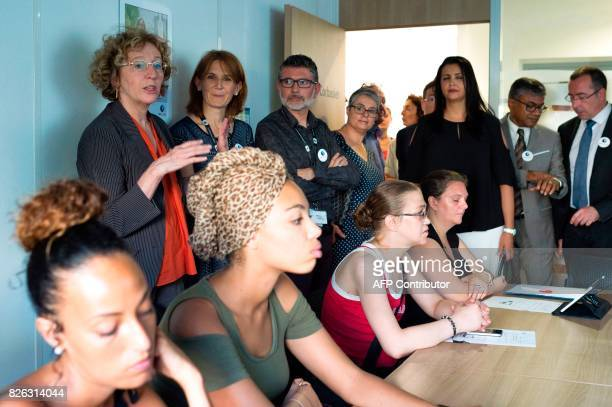 French Labour Minister Muriel Penicaud meets with employees and work-seekers during her visit at an employment office on August 4, 2017 in the Part...