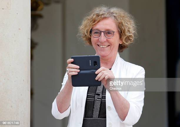 French Labour Minister Muriel Penicaud takes a picture as she leaves the Elysee Presidential Palace after a weekly cabinet meeting on May 23 2018 in...