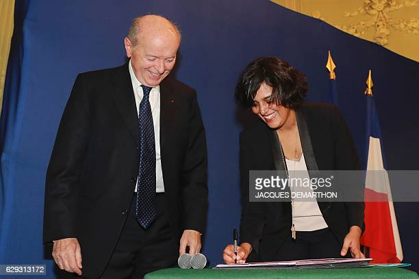 French Labour Minister Myriam El Khomri and French Ombudsman Jacques Toubon take part in a signing ceremony of a convention on the fight against...