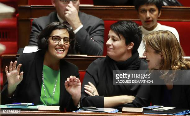 French Labour Minister Myriam El Khomri gestures as she speaks with Memeber of the European Parliament Estelle Grelier and Secretary of state for...