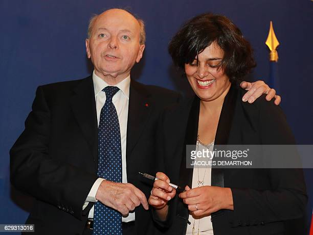 French Labour Minister Myriam El Khomri shares a laugh with French Ombudsman Jacques Toubon during the signing ceremony of a convention on the fight...