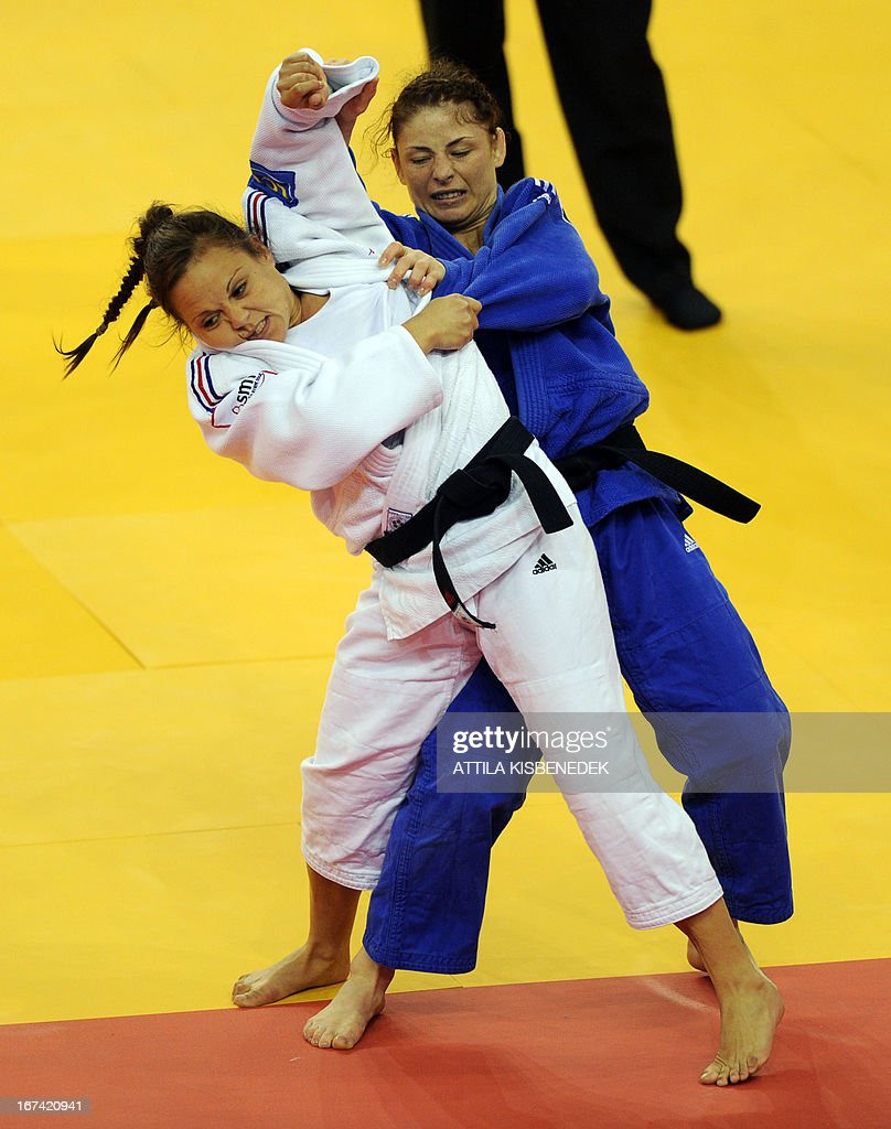 French Laetitia Payet (white) fights with her Romanian opponent, Carmen Bogdan (blue) during Judo European Championships in the women 48 kg category, on April 25, 2013 in Budapest.