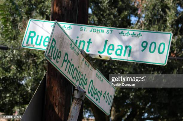 french language street signs, lafayette, louisiana - creole culture stock pictures, royalty-free photos & images