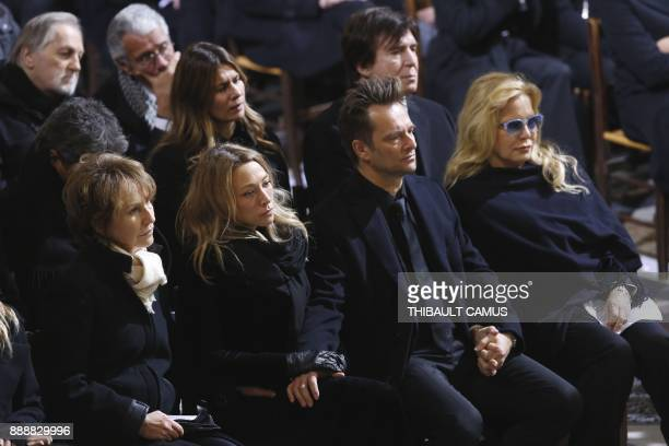 French late singer Johnny Hallyday's former wives actress Nathalie Baye and singer Sylvie Vartan and his children David Hallyday and Laura Smet sit...