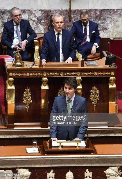 French lawmakers applaud as Canadian Prime Minister Justin Trudeau delivers a speech as Presient of the French National Assembly Francois de Rugy...