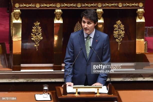 French lawmakers applaud as Canadian Prime Minister Justin Trudeau delivers a speech at the French National Assembly in Paris on April 17 as part of...