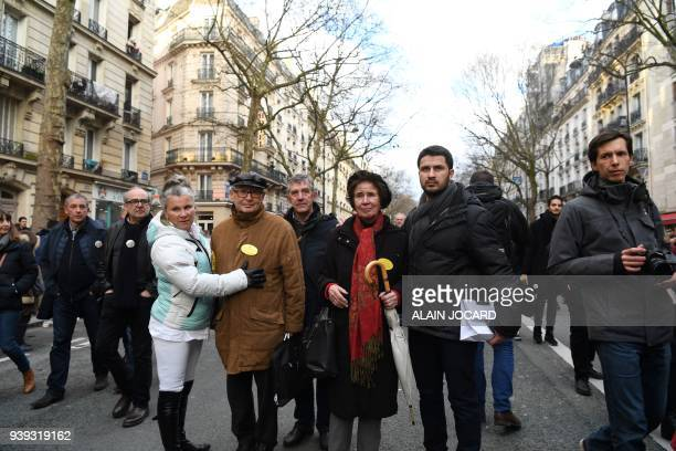 French lawyer and activist Serge Klarsfeld and his wife FrenchGerman journalist and activist Beate Klarsfeld walk with others during a silent march...