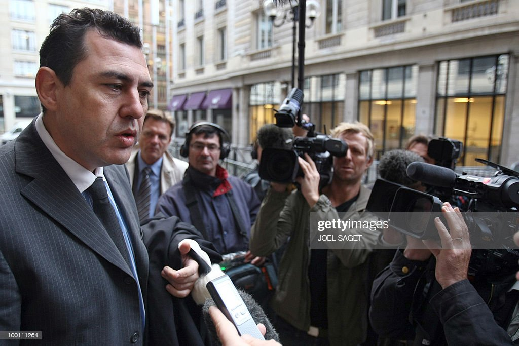 French lawyer Bernard Benaiem (L) of former trader Jerome Kerviel of the French bank Societe Generale (SG) adresses journalists upon his arrival for a hearing at the financial investigation unit of the Paris courthouse, on October 13, 2008. Kerviel, accused of causing multi-billion-euro losses, allegedly abused his bosses' trust and exploited holes in the bank's security system, was charged in August 2008 with 'complicity to fraudulently insert data into a computer system.' One of his lawyers said on October 12, 2008, that Kerviel's fictitious operations were validated by the bank's accountants despite alerts on their validity.