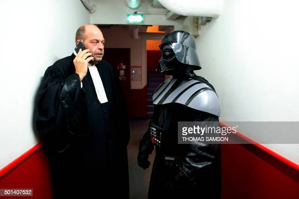 French lawyer Eric DupondMoretti poses next to a person wearing a Darth Vader costume during the Darth Vader's trial event at the Grand Rex movie...