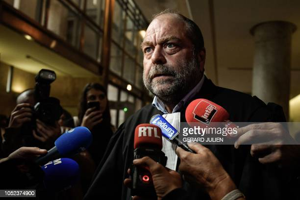 French lawyer Eric Dupond-Moretti speaks to journalists as he leaves the assizes court of Bouches-du-Rhone in Aix-en-Provence, southern France, on...