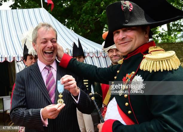 French lawyer Franck Samson, dressed as Napoleon Bonaparte pulls the ear of UK Independence Party leader Nigel Farage at Napoleon Bonaparte...