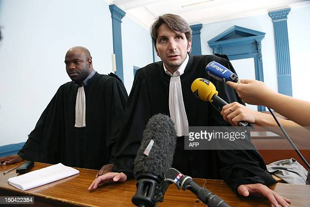 French lawyer Guillaume Demarcq , flanked by Stephane Diboundje, answers journalists questions at the Amiens criminal court on August 17, 2012...