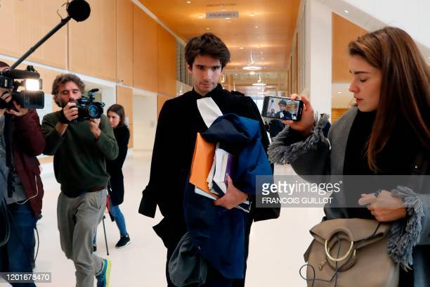 French lawyer Juan Branco an acquaintance of Russian artist Pyotr Pavlensky is surrounded by the press at the Tribunal de Paris courthouse in Paris...