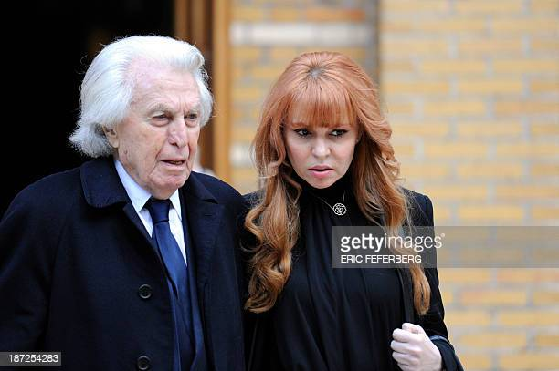 French lawyer Paul Lombard and Anouchka Weiss leave the Saint Honore d'Eylau church in Paris after the funeral ceremony of French prolific spy...