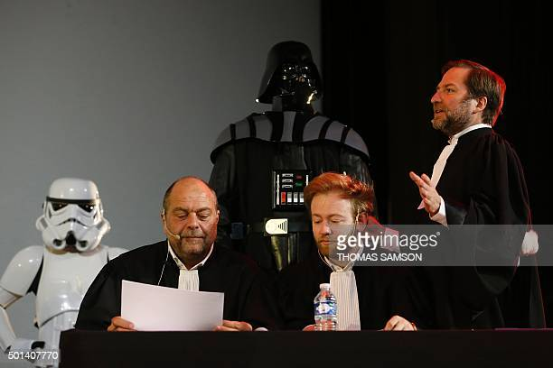 French lawyers Eric DupondMoretti and Antoine Vey listen to fellow lawyer Patrice Spinosi as they sit next to a person wearing a Darth Vader costume...